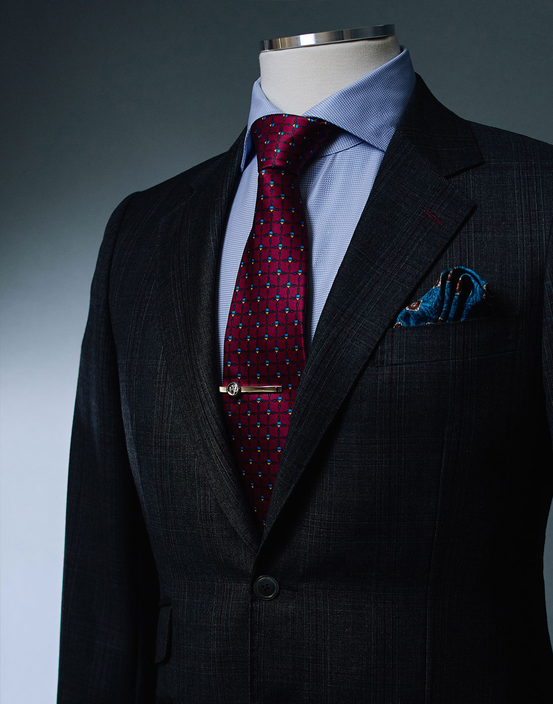 Men's bespoke suit jacket with a red tie